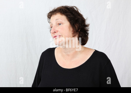 Bored fed up weary 50s 60s late middle aged woman with expressive facial expression - Stock Photo