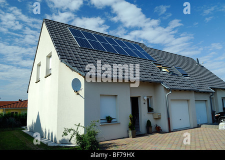 photovoltaic solar power energy panels on the roof of a private house - Stock Photo