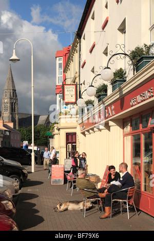 Guys Bar in Clifden; pavement café and pub in Clifden, Connemara, Ireland - Stock Photo