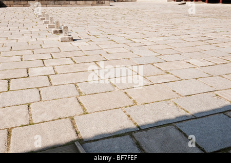 The cobbled plaza in front of the Injeongjeon throne hall of Changdeokgung Royal Palace in Seoul - Stock Photo