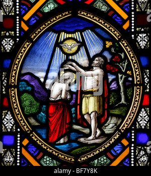 Detail from the east stained glass window by J & J King of Norwich depicting the Baptism of Jesus Christ - Stock Photo