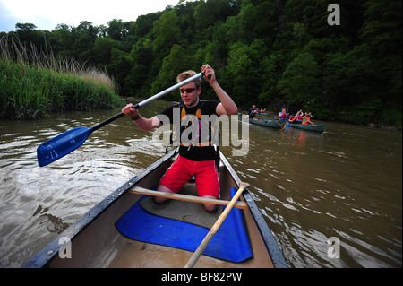 An Instructor canoeing and kayaking on the river Tamar, on the Devon and Cornwall border, UK - Stock Photo