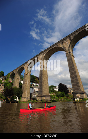 A man and a woman canoeing and kayaking on the river Tamar, on the Devon and Cornwall border, UK, in the village - Stock Photo
