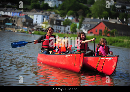 A family canoeing and kayaking on the River Tamar, on the Devon and Cornwall border, UK - Stock Photo