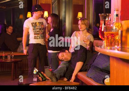group of people in nightclub, dancing - Stock Photo