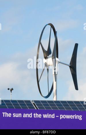 Small wind turbine and solar panels on the top of the Seabird Centre, North Berwick, Scotland. - Stock Photo