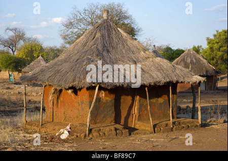 Traditional Zambian huts in Nsongwe village near Livingstone. - Stock Photo