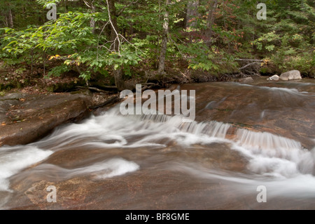Ancient glacially carved stream runs through 'The Basin' in Franconia Notch State Park, New Hampshire, USA - Stock Photo