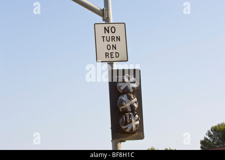 Description field: this traffic signal in Orange County, California is covered up before it is put into service. - Stock Photo