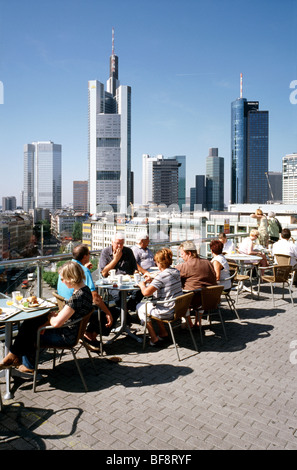 Aug 15, 2009 - People at Les Facettes with views of the banking district in the German city of Frankfurt. - Stock Photo