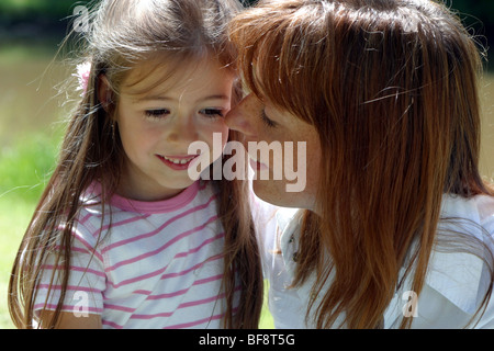 Adult talking to child - Stock Photo