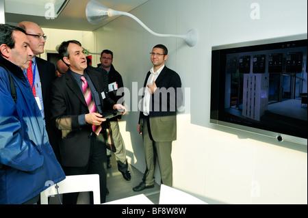 Paris, France, Businessmen Visiting Construction Equipment Trade Show,  Batimat, Be-Green Eco-House, Man Explaining - Stock Photo