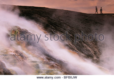 Hiker at hot spring, Yellowstone National Park, Wyoming - Stock Photo