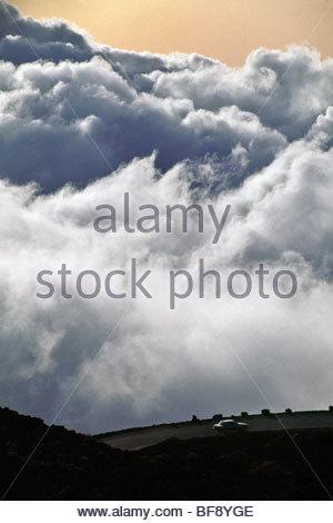 Car on road to summit of Haleakala crater, Maui, Hawaii - Stock Photo