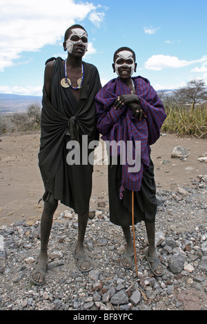 Young Masai Boys With Painted Faces After Their Circumsion Ritual Near Ngorongoro Crater, Rift Valley, Tanzania - Stock Photo