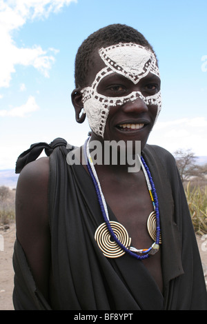 Young Masai Boy With Painted Faces After Their Circumsion Ritual Near Ngorongoro Crater, Rift Valley, Tanzania - Stock Photo