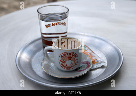 turkish coffee known as cypriot coffee in the republic of cyprus europe served with a glass of water for drinking - Stock Photo