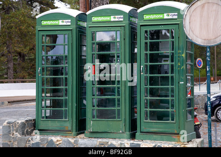 three old british telephone boxes painted green now owned by cyta cyprus telecom in troodos square republic of cyprus - Stock Photo