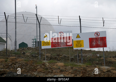 radiation warning signs on fence at british military observation post on mount olympus republic of cyprus - Stock Photo