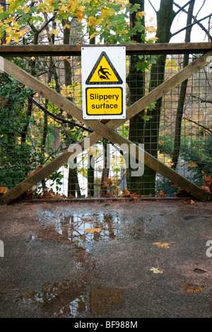wet slippery surface sign - Stock Photo