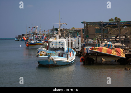 fishing boats tied up in potamos typical small unspoilt fishing village republic of cyprus europe - Stock Photo