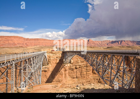 Navajo Bridges old and new over Colorado River on Highway 89A, Marble Canyon, Echo Cliffs in distance, Arizona, - Stock Photo