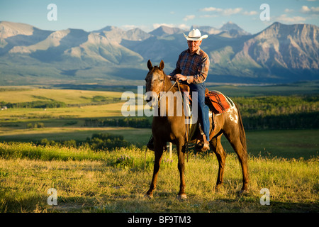 cowboy near Waterton Lakes National Park, Alberta, Canada (no model release) - Stock Photo