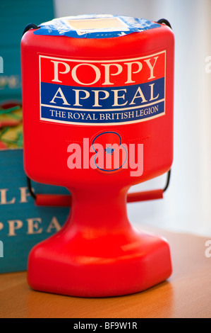 The Royal British Legion poppy appeal. Charity collection tin with a red poppy on the front taking money for old - Stock Photo