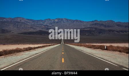 lonely 'car journey' empty road long Nevada desert - Stock Photo