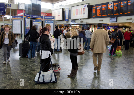 Tourists and commuters in Euston railway Station, London - Stock Photo
