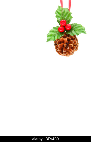 Holly berry and pine cone as Christmas ornament isolated on white - Stock Photo