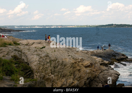 Scenic view of rugged rocky coastline looking out towards Newport from Beavertail on Narragansett bay in Rhode Island. - Stock Photo
