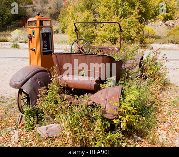 A very old car by a fuel pump in Mogollon in New Mexico USA - Stock Photo