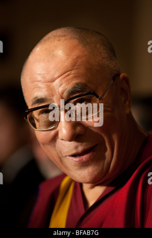 Dalai Lama Tenzin Gyatso, speaking at a function. - Stock Photo