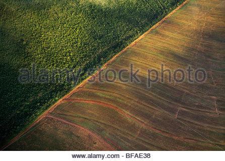 Industrial farmland surrounding cerrado habitat (aerial), near Emas National Park, Brazil - Stock Photo
