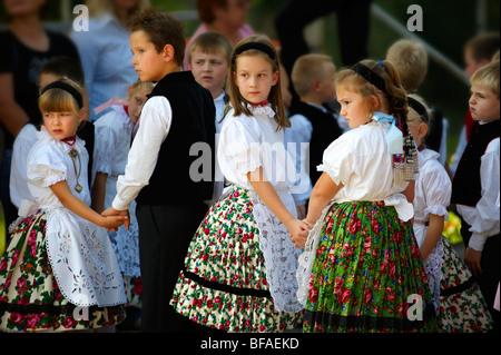 Svab Hungarian children in traditional costume at the Hajos wine festival, Hungary - Stock Photo