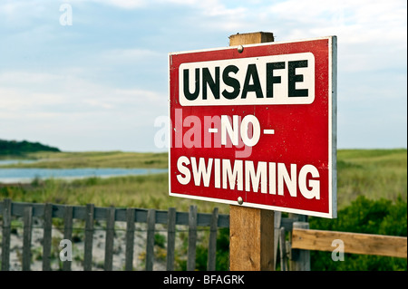 Warning sign of unsafe beach, Nauset Beach, Orleans, Cape Cod, MA, USA - Stock Photo