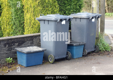 2 wheelie bins and 2 recycling boxes lined up outside the house on the drive waiting collection by the refuse collectors - Stock Photo
