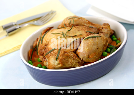 Chicken with tarragon. . Recipe available. - Stock Photo