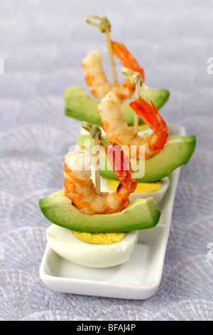 Eggs and prawns appetizers. Recipe available. - Stock Photo