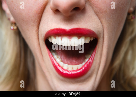 Young woman screaming - Stock Photo