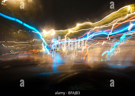 Long exposure of urban lights at night from a moving car. - Stock Photo