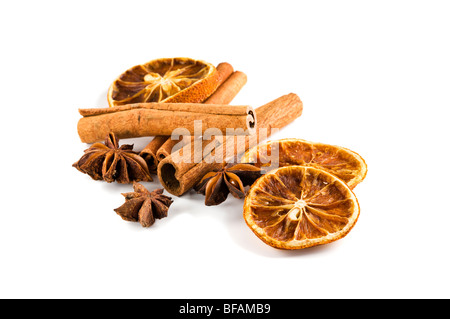winter scents - cinnamon sticks, dried orange slices and star anise on white background Stock Photo