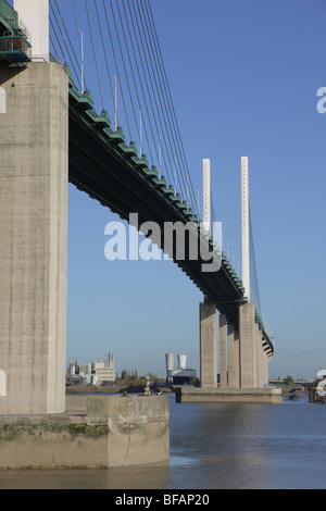 The Queen Elizabeth Bridge over the river Thames at Dartford, photographed from the Kent shore - Stock Photo