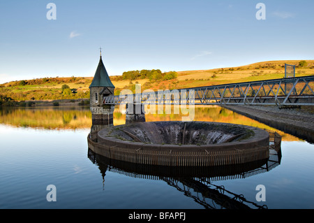 Pontsticill Reservoir (known locally as Dolygaer Lake) in the Brecon Beacons in Mid-Wales early evening with reflection - Stock Photo