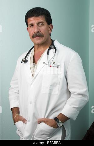 Doctor studio background, portrait, direct to camera - Stock Photo