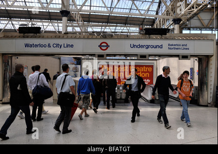 Commuters at the entrance to the London Underground at Waterloo Station, London, England, UK. - Stock Photo