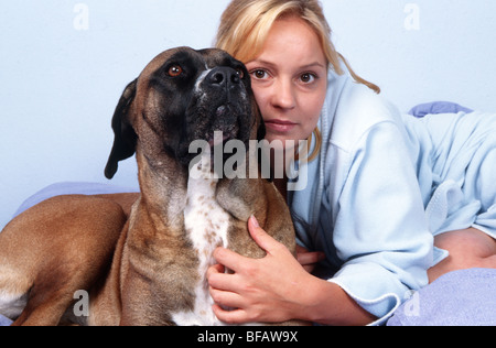 Woman, one only and dog - Woman petting dog - Stock Photo