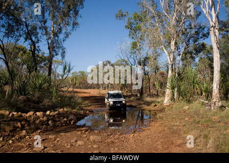 Camper van crossing creek on the Gibb River RoaGibb River Road – former drovers track through the Kimberley in Western - Stock Photo