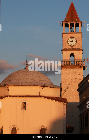 Ethem Bey Mosque and the clock tower in Skanderbeg Square, Tirana, Albania - Stock Photo